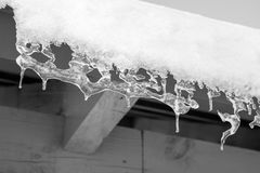 Icicles. Hanging from a roof Royalty Free Stock Photography