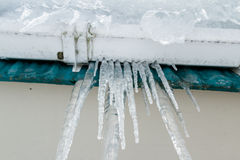 Icicles hanging from the roof Stock Images