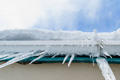Icicles hanging from the roof Stock Photos