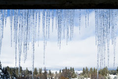 Icicles hanging from the roof Royalty Free Stock Photo