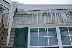 Icicles hanging from the roof. Closeup of icicles hanging from the roof Royalty Free Stock Photo