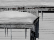 Icicles hanging from roof Stock Images