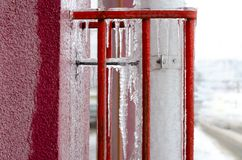 Icicles hanging on water drain pipe royalty free stock photo