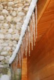 Icicles Hanging from Wooden Building Royalty Free Stock Image