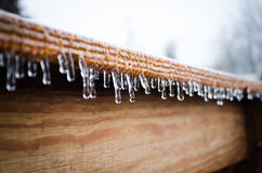 Icicles hanging from a wooden roof