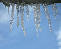 Icicles heap on blue sky, winter environment, Royalty Free Stock Images