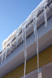 Icicles on house eaves Stock Photography