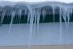 Icicles on the house. many icicles thaw. Fot horizontal for your design royalty free stock photography