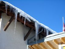 Icicles on house roof Royalty Free Stock Photos