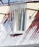 Icicles on the house window. In the park in nature Royalty Free Stock Photography