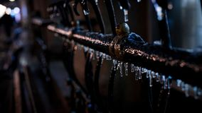 Icicles icy frozen iron rail. Winter in the evening street icy frozen iron rail many cold, chill, coldness, freeze, algidityicicles royalty free stock photography
