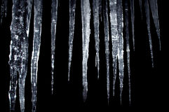 Icicles insulation on a black Stock Photo