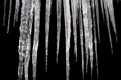 Icicles insulation on a black Stock Photos
