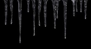 Icicles isolated on black background stock images