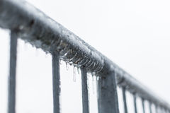 Icicles melting on a fence. Sleet Royalty Free Stock Photo