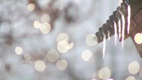Icicles melting spring bokeh stock footage