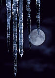 Icicles and the moon Stock Photography