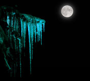 Icicles in moonlight Royalty Free Stock Photo