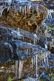 Icicles on a mountain cliff Royalty Free Stock Images