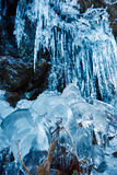 Icicles on mountain wall Royalty Free Stock Photo