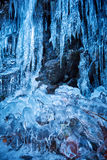 Icicles on mountain wall Stock Images