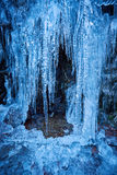 Icicles on mountain wall Royalty Free Stock Photography
