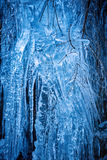 Icicles on mountain wall Stock Photo