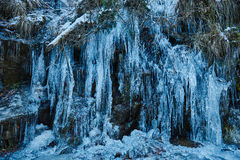Icicles on mountain wall Stock Photos
