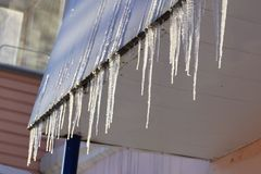 Icicles on the office building. Meteo forecast coming cold Stock Photo