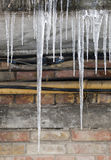 Icicles on the old house in the winter Royalty Free Stock Images