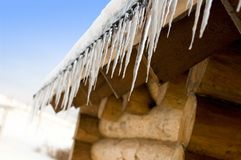 Icicles on an old log-house Royalty Free Stock Photos
