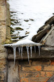 Icicles on an old roof Stock Image