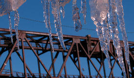 Icicles Over the Cuyahoga River, Cleveland, Ohio. Winter in Cleveland, Ohio, Cuyahoga River, icicles on roof, USA Royalty Free Stock Images
