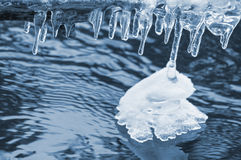 Icicles over water Royalty Free Stock Photography