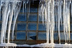 Icicles over window Royalty Free Stock Image