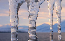 Icicles sunset mountains Royalty Free Stock Photo