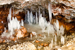 Icicles in a rock cave Royalty Free Stock Photography