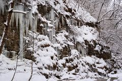 Icicles on rocks royalty free stock photography