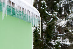 Icicles on a roof Stock Images
