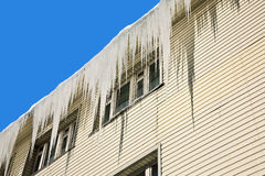 Icicles on a roof Royalty Free Stock Photo