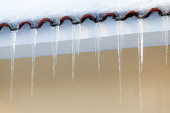 Icicles on a roof Royalty Free Stock Photos