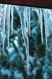 Icicles on the roof. Icicles formed on a wooden roof Royalty Free Stock Photography