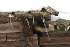 Icicles on a Roof Stock Photo