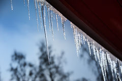 Icicles on a roof Stock Photography