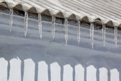 Icicles on roof Royalty Free Stock Photos