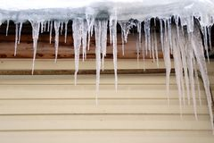 Icicles on the roof. Royalty Free Stock Image