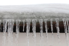 Icicles on the roof, frozen water. cold winter weather concept, soft focus, shallow depth of field. macro front view Stock Photography
