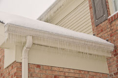 Icicles On The Roof Gutters stock photos