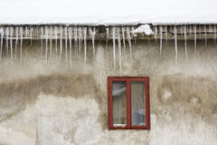 Icicles on the roof Stock Photos