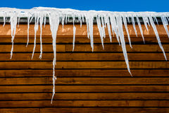 Icicles and Roof Stock Image